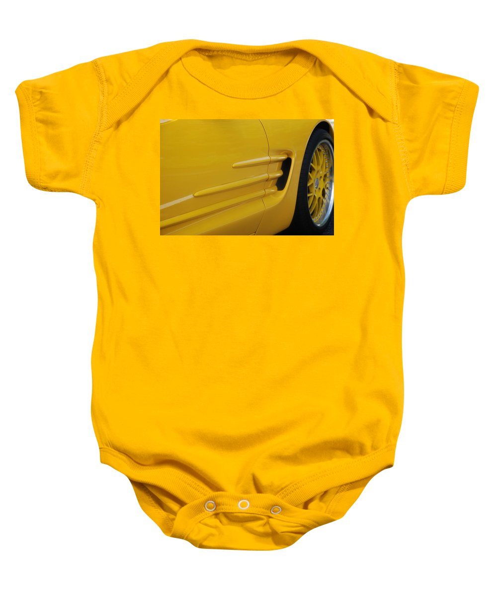 Corvette Baby Onesie featuring the photograph Yellow Vette by Rob Hans