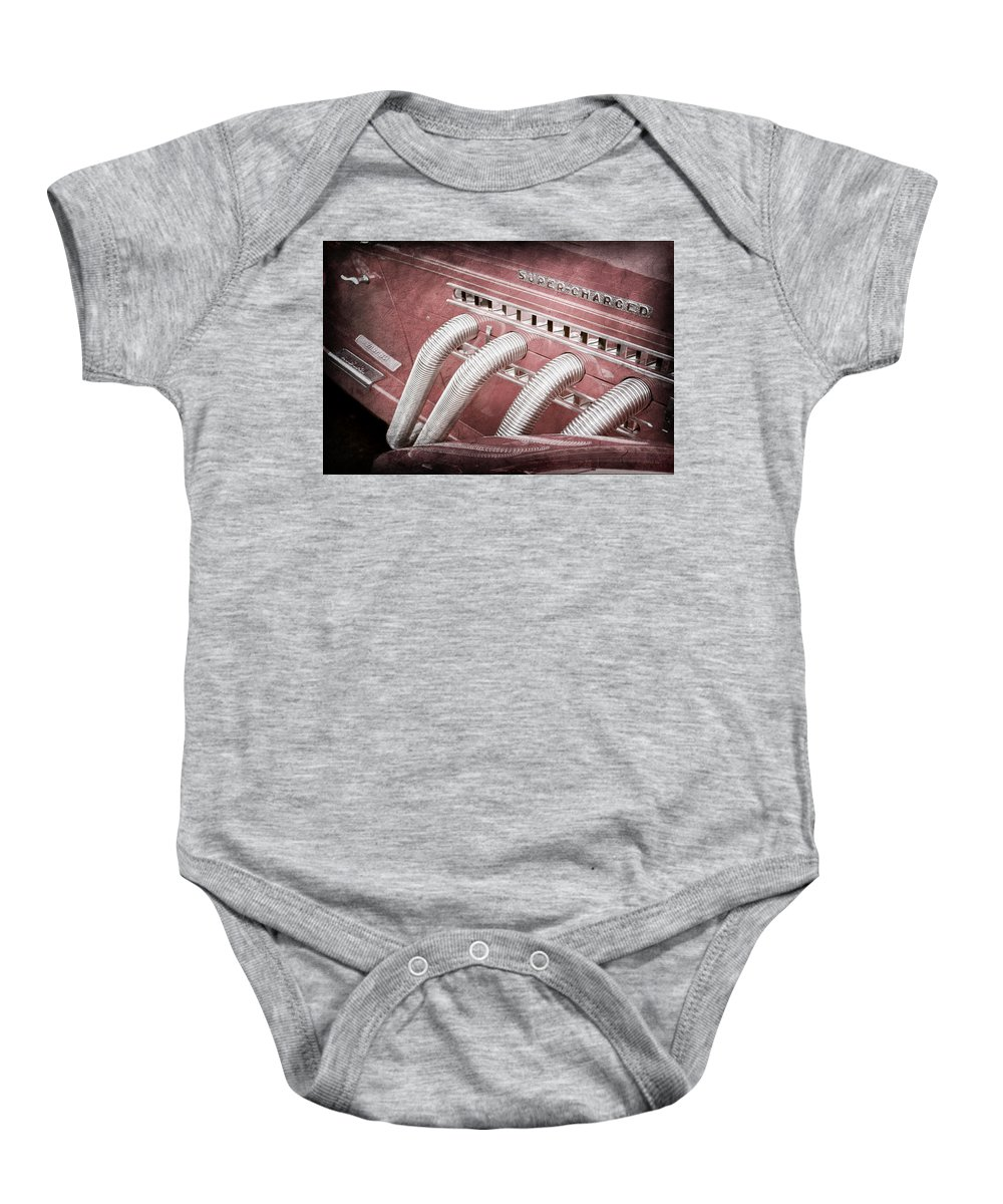 1935 Auburn Side Pipes Baby Onesie featuring the photograph 1935 Auburn Side Pipes - Emblem by Jill Reger