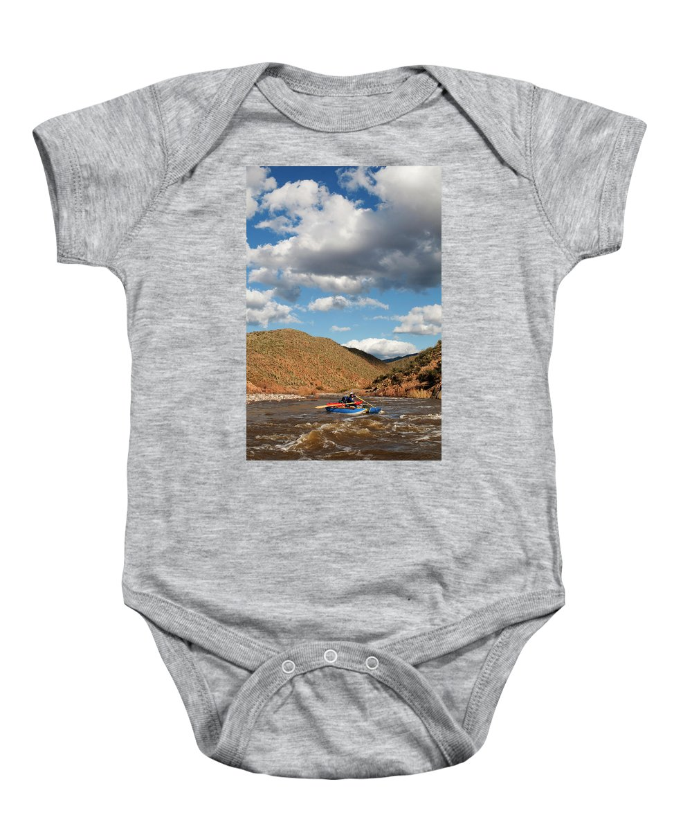 20s Baby Onesie featuring the photograph A Whitewater Rafters Rows His Boat by Kyle George