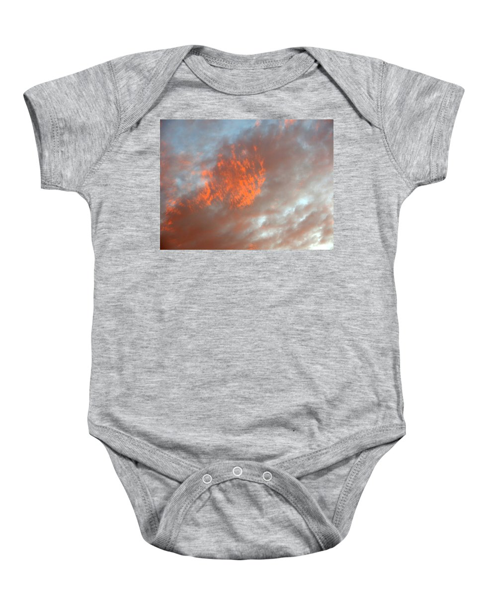 Color Baby Onesie featuring the photograph Fireball In The Sky by Jean Macaluso