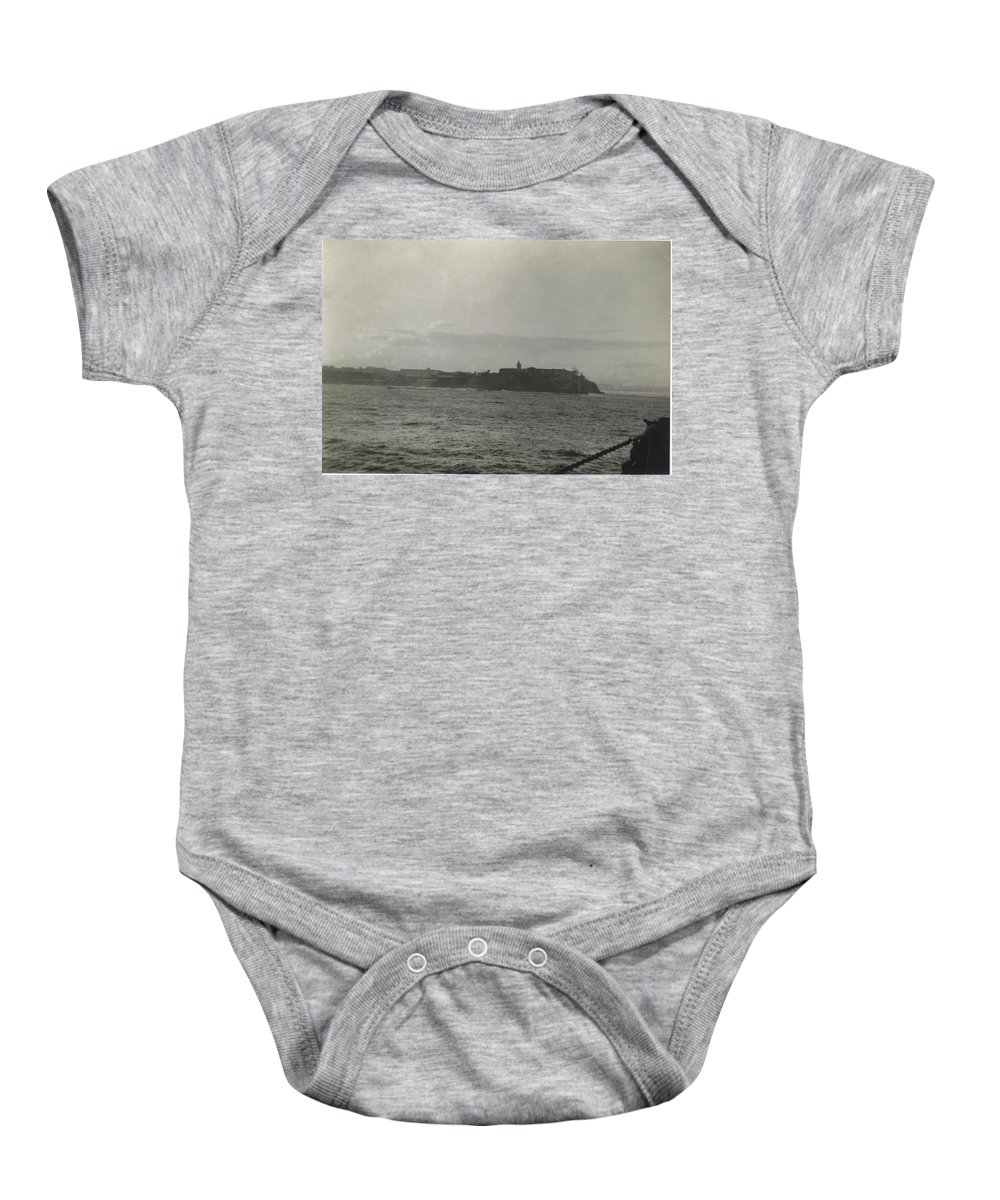 Fort In The Distance As We Approached San Juan Baby Onesie featuring the photograph Fort At San Juan In Puerto Rico by Robert Floyd