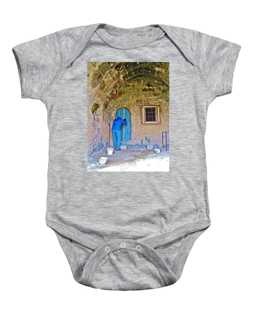 Knocking On A Blue Door Of Tufa Home In Goreme In Cappadocia Baby Onesie featuring the photograph Knocking On A Blue Door Of Tufa Home In Goreme In Cappadocia-turkey by Ruth Hager
