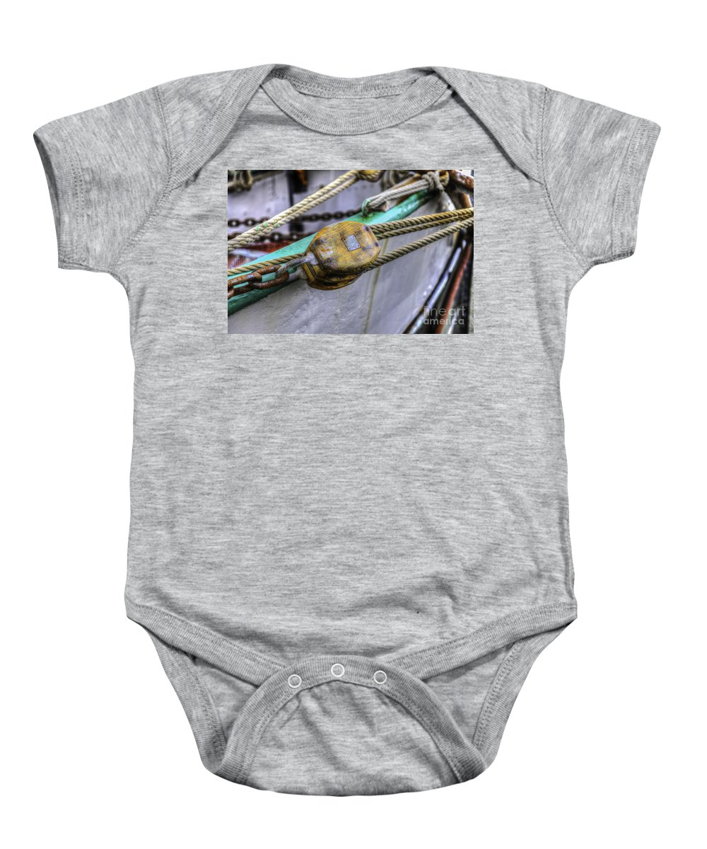 Tall Ship Baby Onesie featuring the photograph Tall Ship Wooden Line Block by Dale Powell
