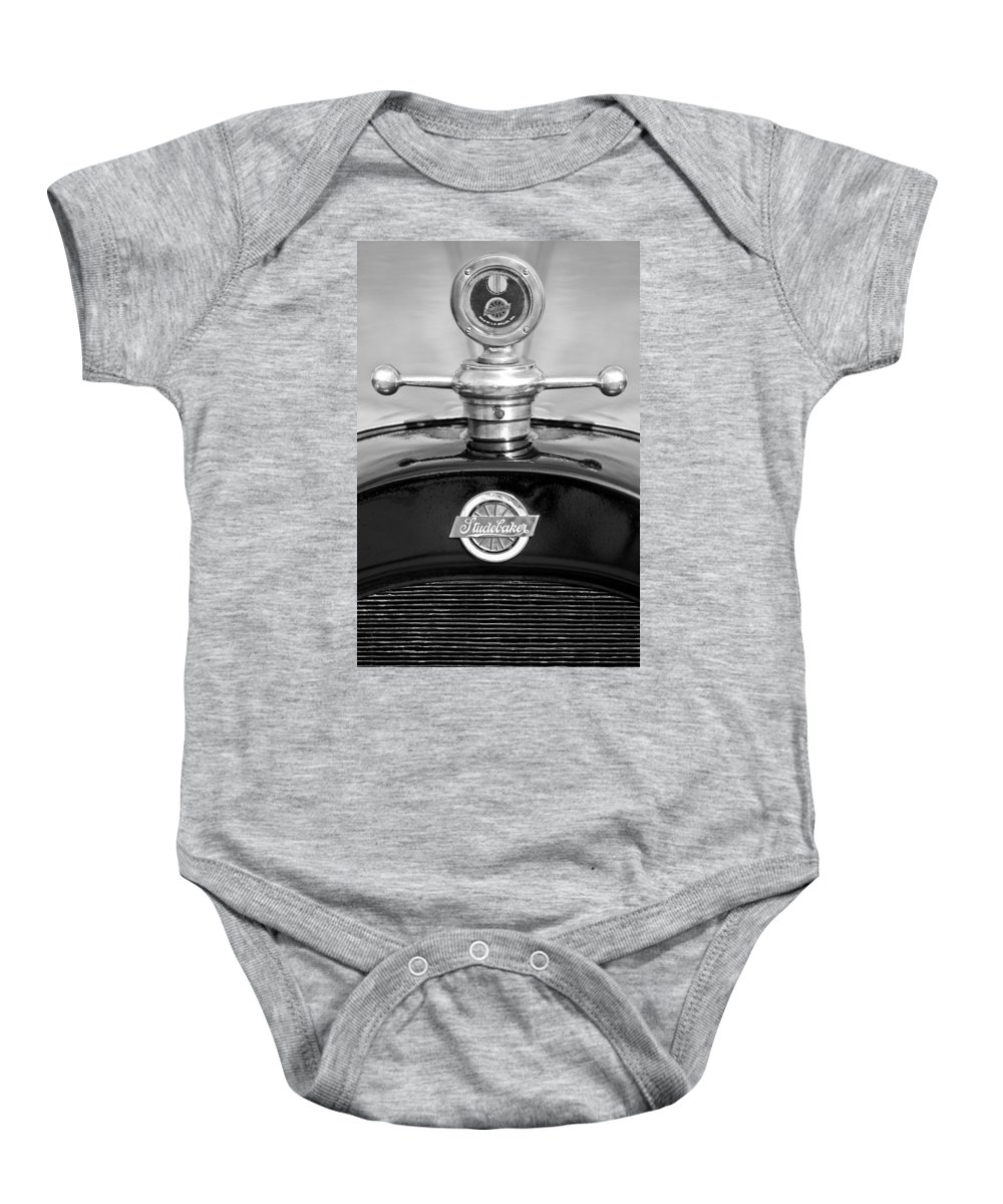 1922 Studebaker Touring Baby Onesie featuring the photograph 1922 Studebaker Touring Hood Ornament 3 by Jill Reger
