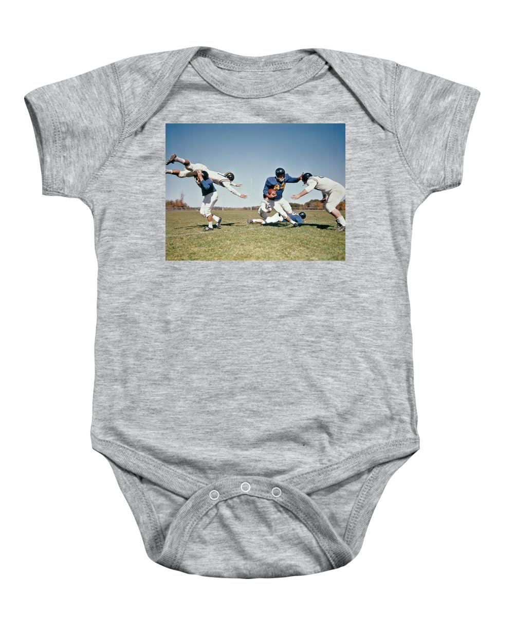 Photography Baby Onesie featuring the photograph 1960s Football Player Running With Ball by Vintage Images