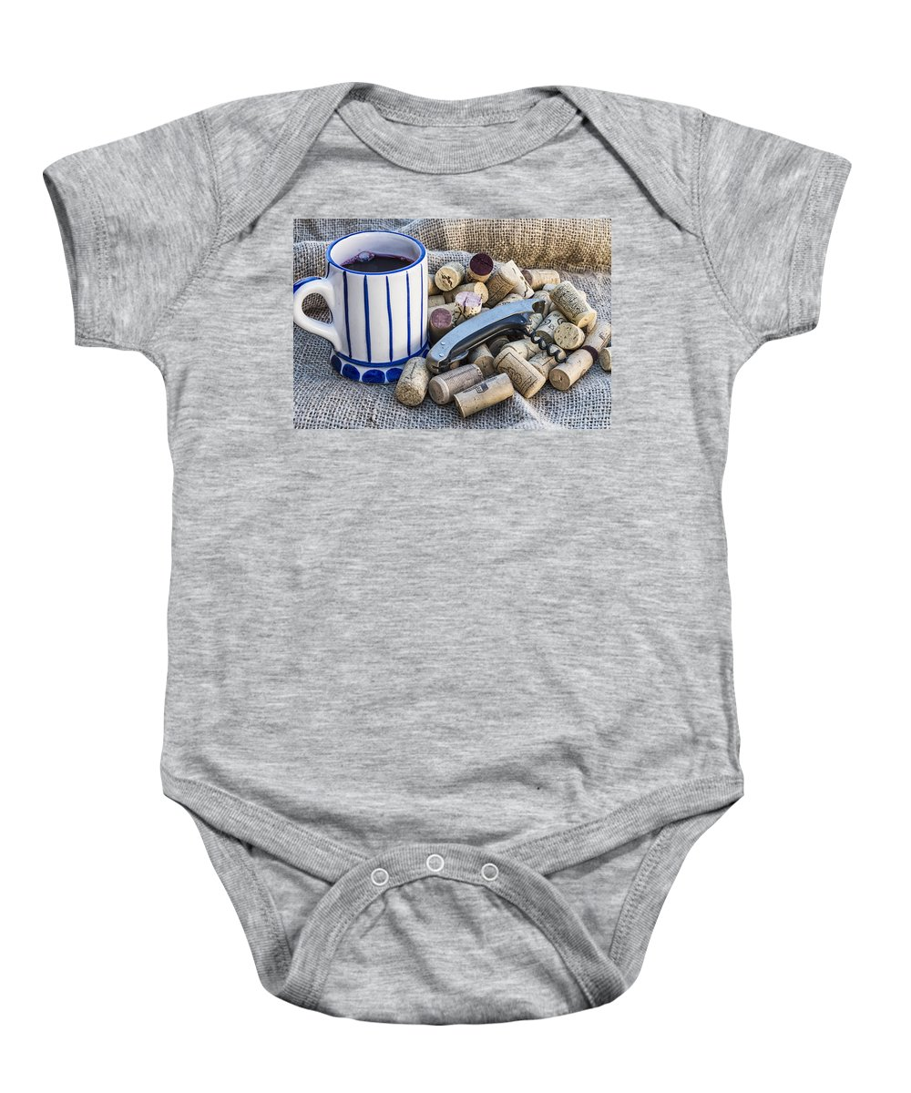 Alcohol Baby Onesie featuring the photograph Corks With Corkscrew by Paulo Goncalves