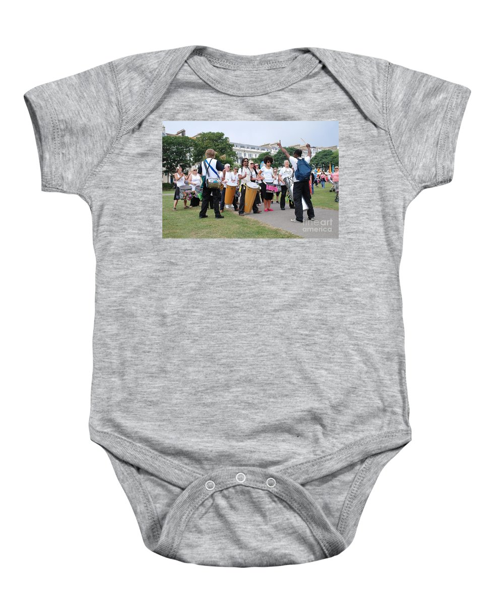 Dende Baby Onesie featuring the photograph Dende Nation Samba Drum Troupe by David Fowler
