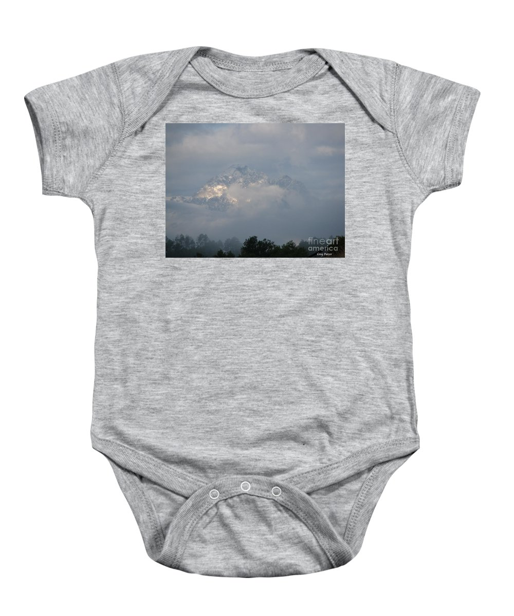 Rocky Mountains Baby Onesie featuring the photograph Out Of The Clouds by Greg Patzer