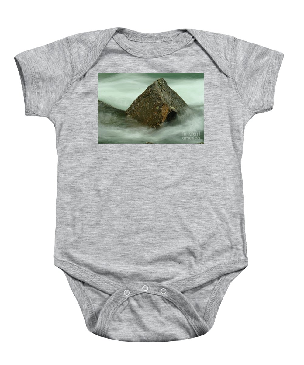 Rocks Baby Onesie featuring the photograph The Unmoveable by Jeff Swan