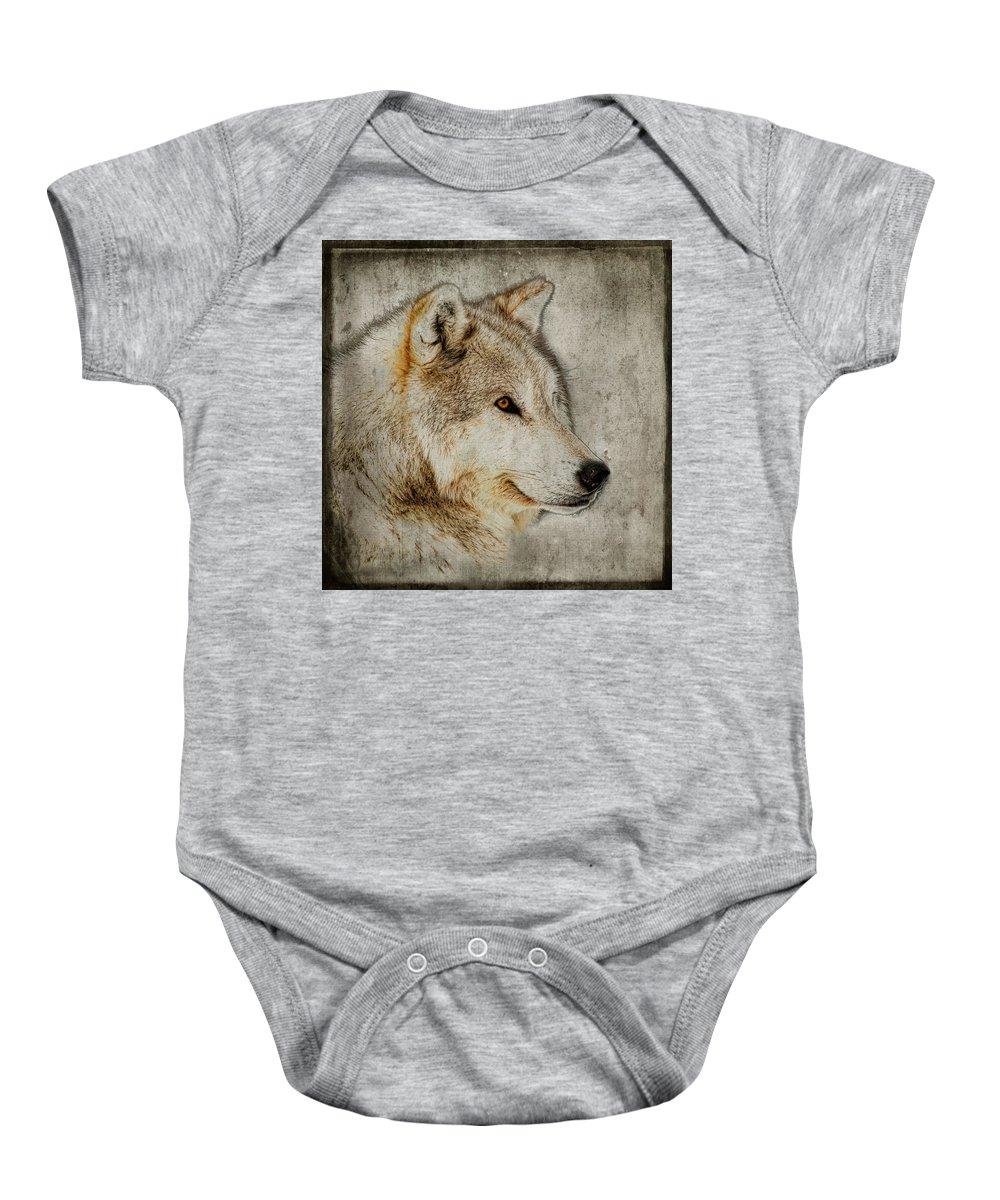 Wolf Art Baby Onesie featuring the photograph The Wolf by Steve McKinzie