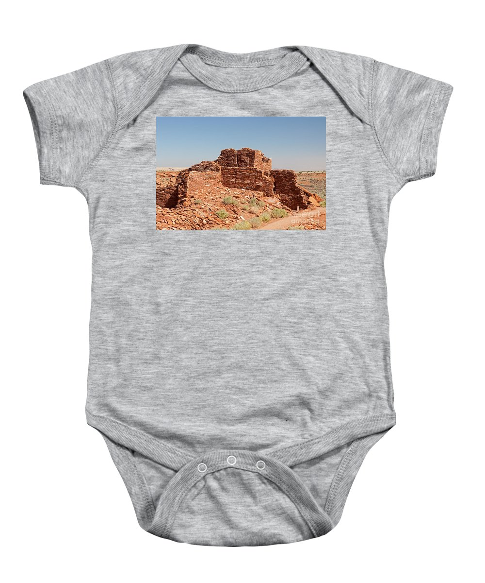 Arizona Baby Onesie featuring the photograph Wupatki Pueblo In Wupatki National Monument by Fred Stearns