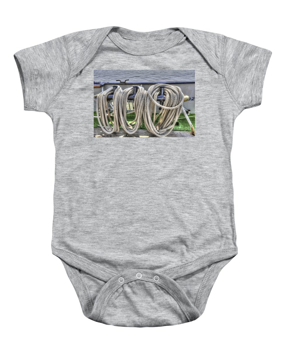 Tall Ship Baby Onesie featuring the photograph Tall Ship Line Holder by Dale Powell