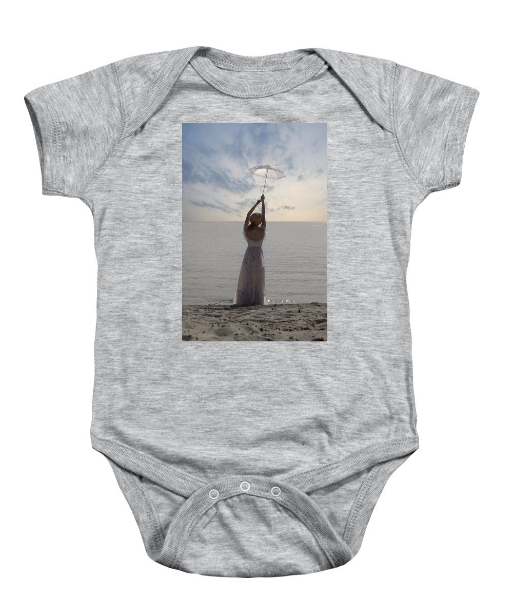 Woman Baby Onesie featuring the photograph Woman At The Beach by Joana Kruse