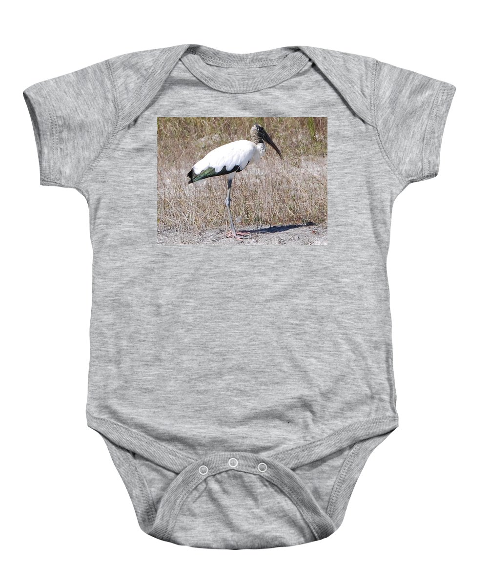 Standing Alone Baby Onesie featuring the photograph Wood Stork by Robert Floyd