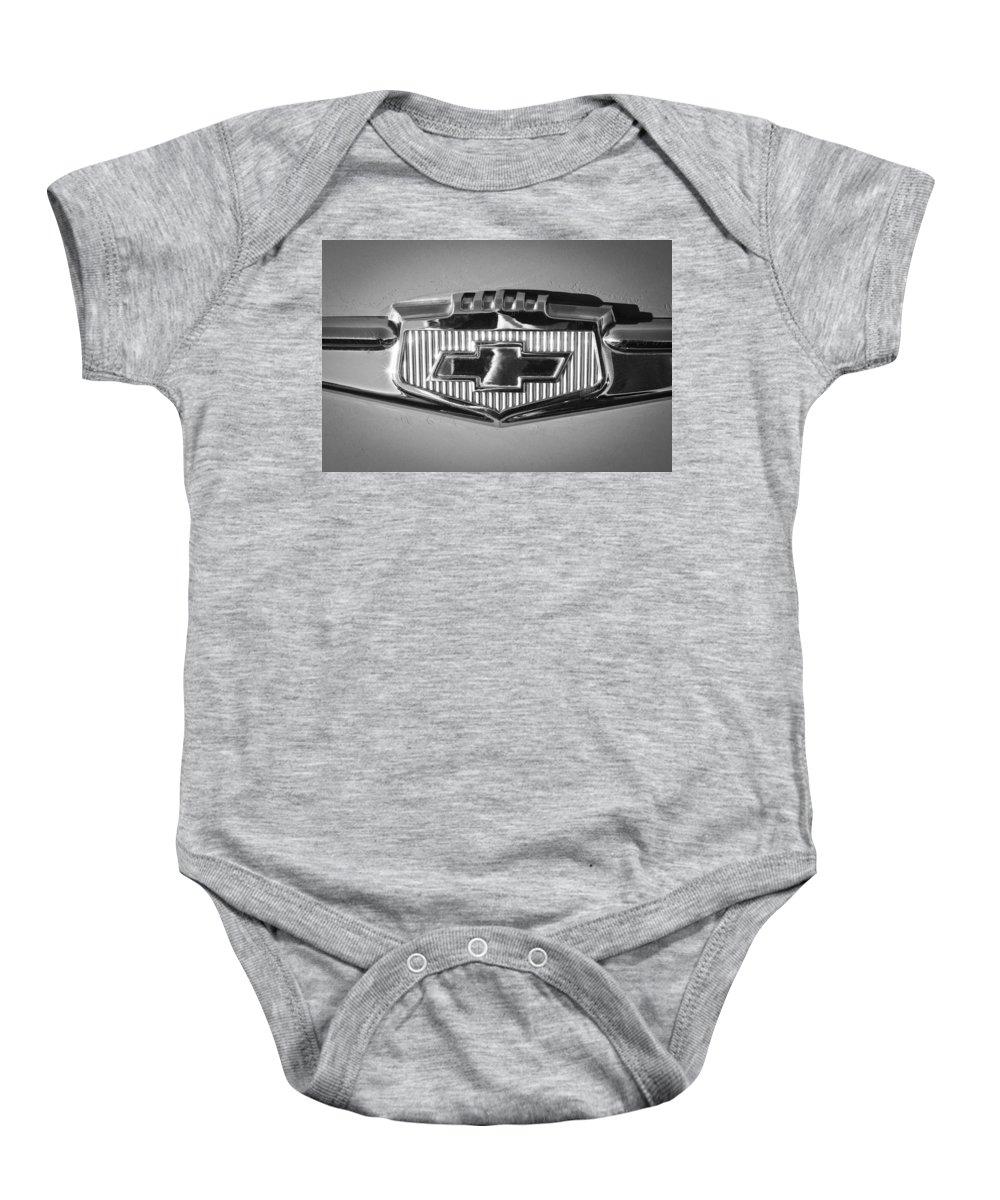 Chevrolet Emblem Baby Onesie featuring the photograph Chevrolet Emblem by Jill Reger