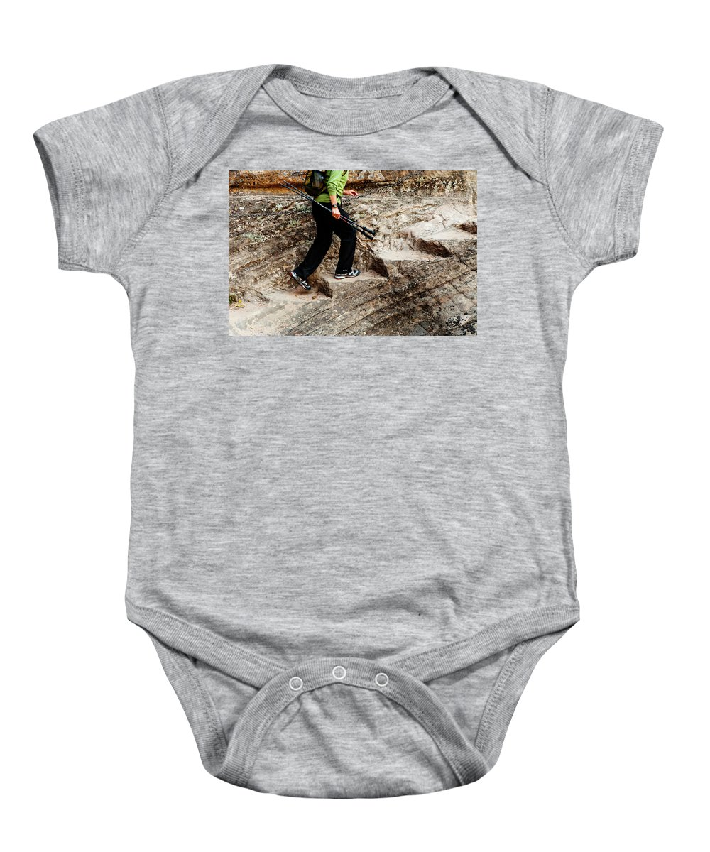 Walking Baby Onesie featuring the photograph A Female Hiker Walking Up Steps Chopped by Ron Koeberer