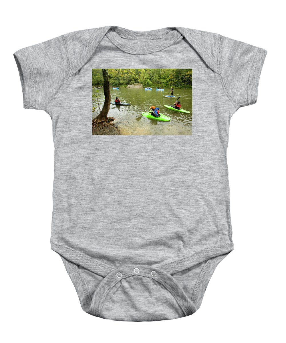 Action Baby Onesie featuring the photograph A Group Of Kayakers, Rafters by Trevor Clark