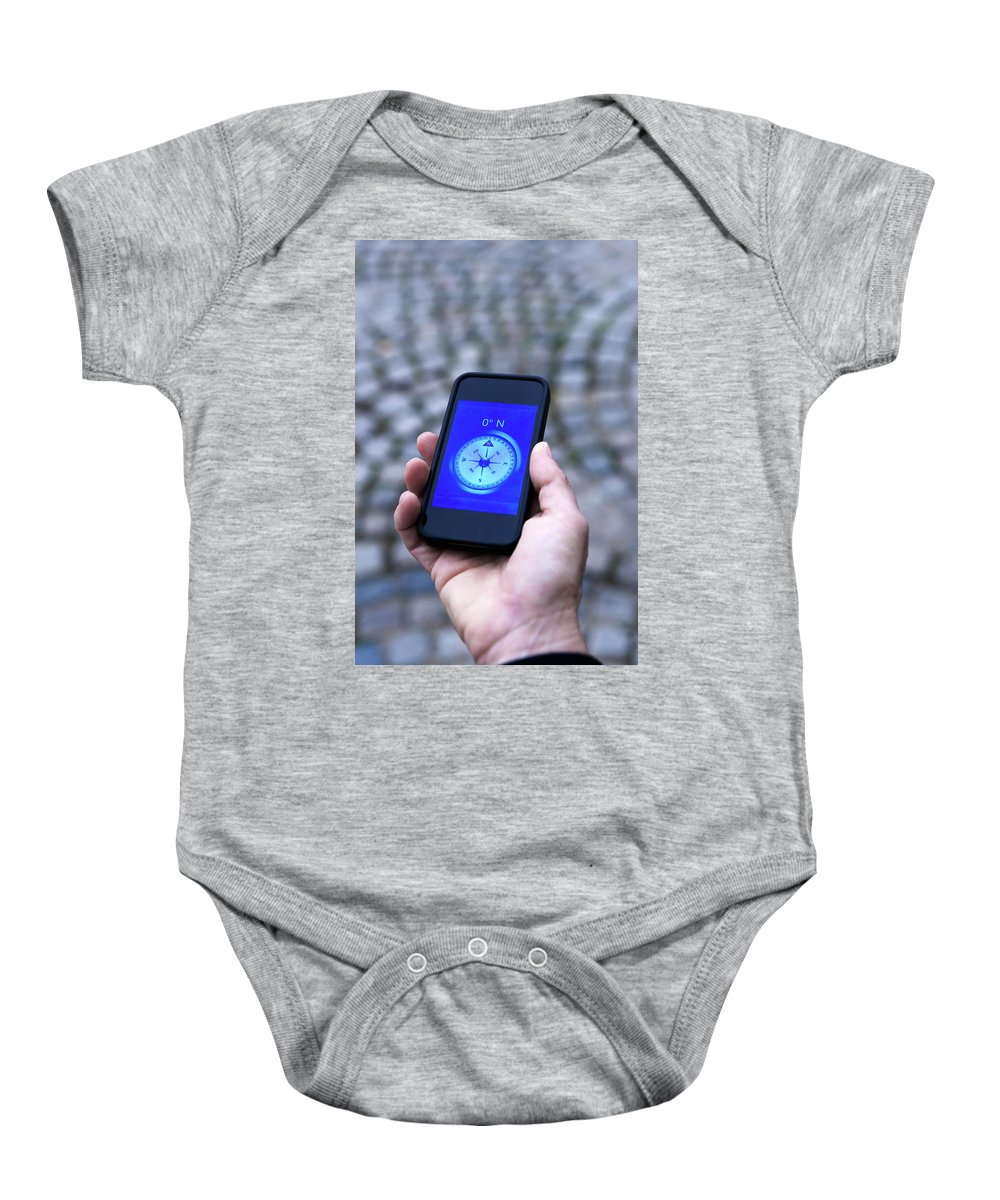 50-54 Years Baby Onesie featuring the photograph A Hand Holding A Digital Compass by Ron Koeberer