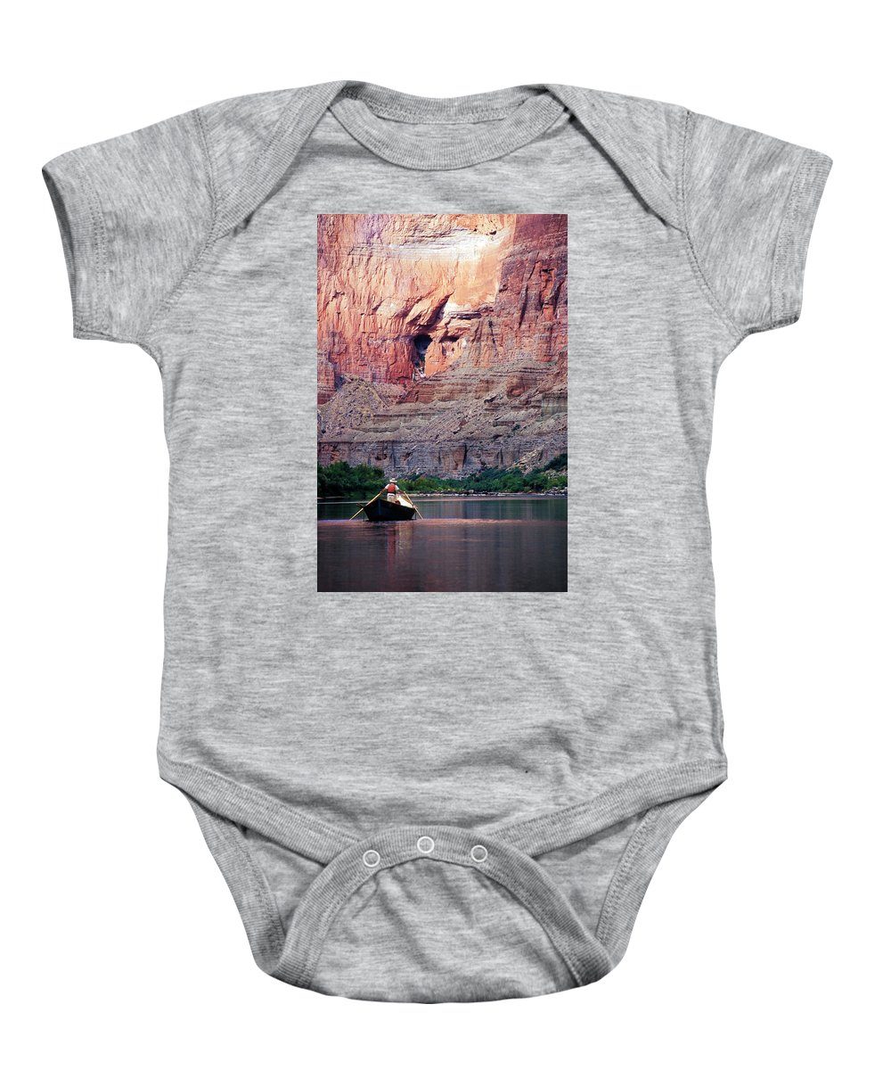 Arizona Baby Onesie featuring the photograph A River Guide Rowing A Wooden Dory by Kyle George