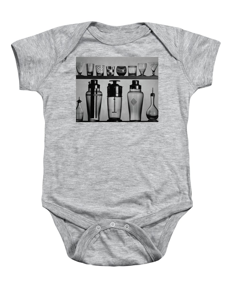 Accessories Baby Onesie featuring the photograph A Row Of Glasses On A Shelf by The 3