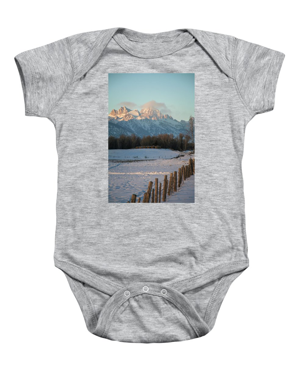 Wyoming Baby Onesie featuring the photograph A Winter Scene Of A Snowy Field, Fence by Mat Rick Photography