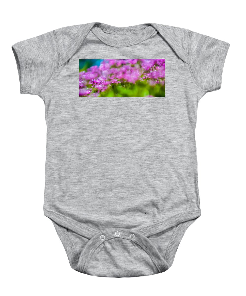 Abstract Baby Onesie featuring the photograph abstract Blurry pink flower background for backgrounds by Alex Grichenko