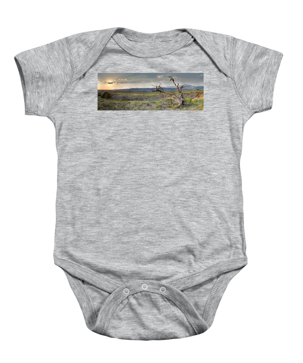 Alamosa Baby Onesie featuring the photograph Across A Great Wilderness by OLena Art Brand