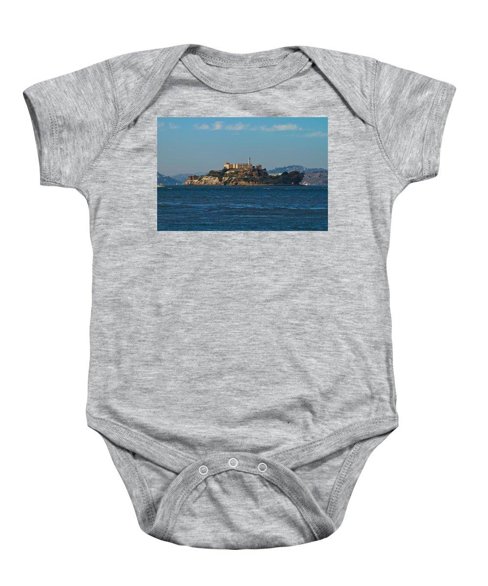 Alcatraz Baby Onesie featuring the photograph Alcatraz Island In San Francisco Bay by Jit Lim