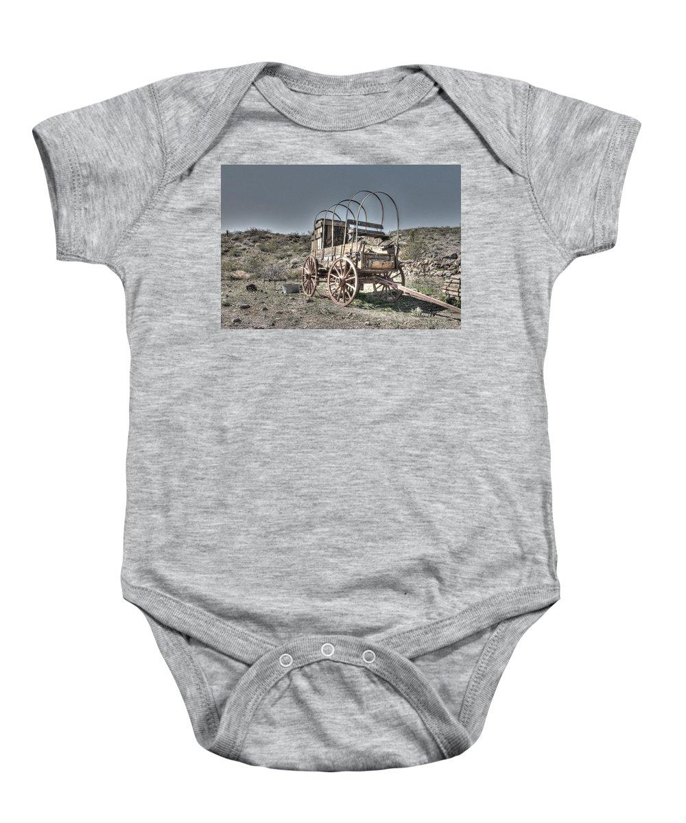 Arizona Baby Onesie featuring the photograph Arizona Wagon by Mark Valentine