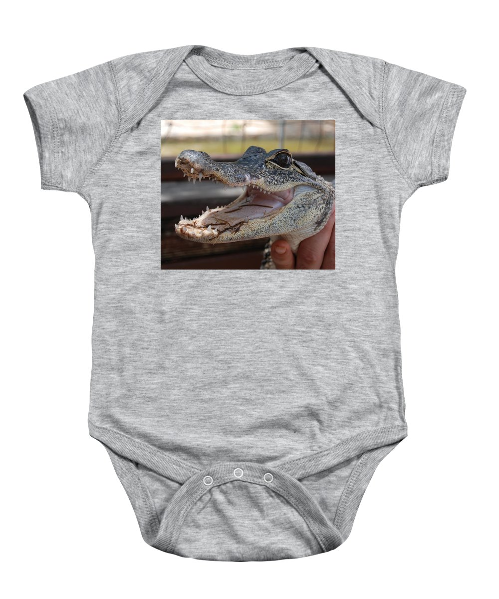 Macro Baby Onesie featuring the photograph Baby Gator by Rob Hans