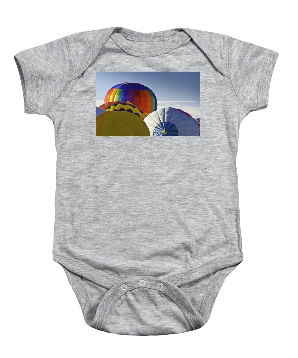 Albuquerque Baby Onesie featuring the photograph Balloon Pillows by Jon Zich