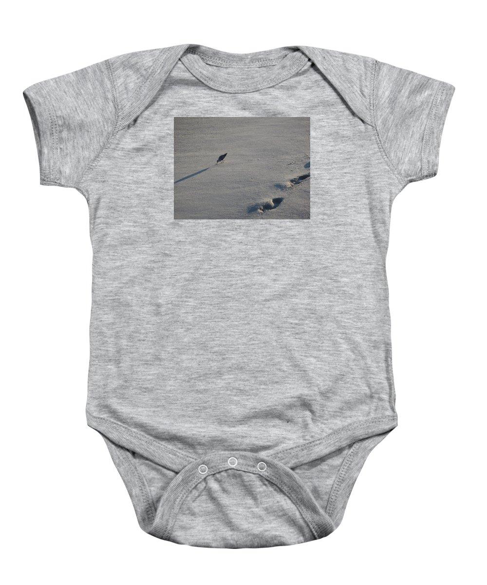 Beach Baby Onesie featuring the photograph Beachcombing Plover by Robert Nickologianis