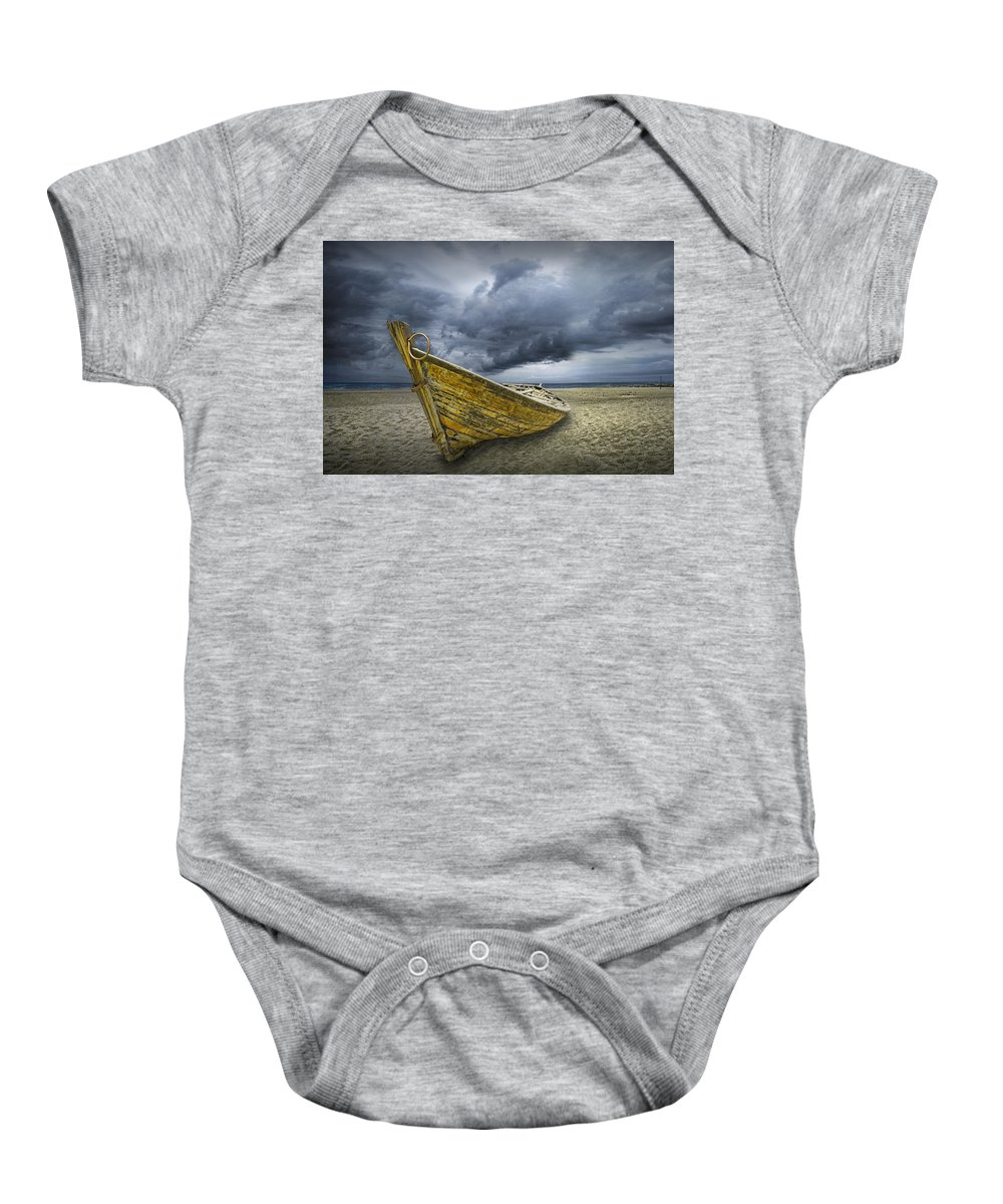 Art Baby Onesie featuring the photograph Boat On The Beach With Oncoming Storm by Randall Nyhof