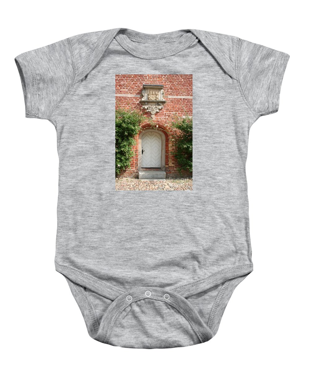 Brick Baby Onesie featuring the photograph Brickcastle And White Door by Christiane Schulze Art And Photography