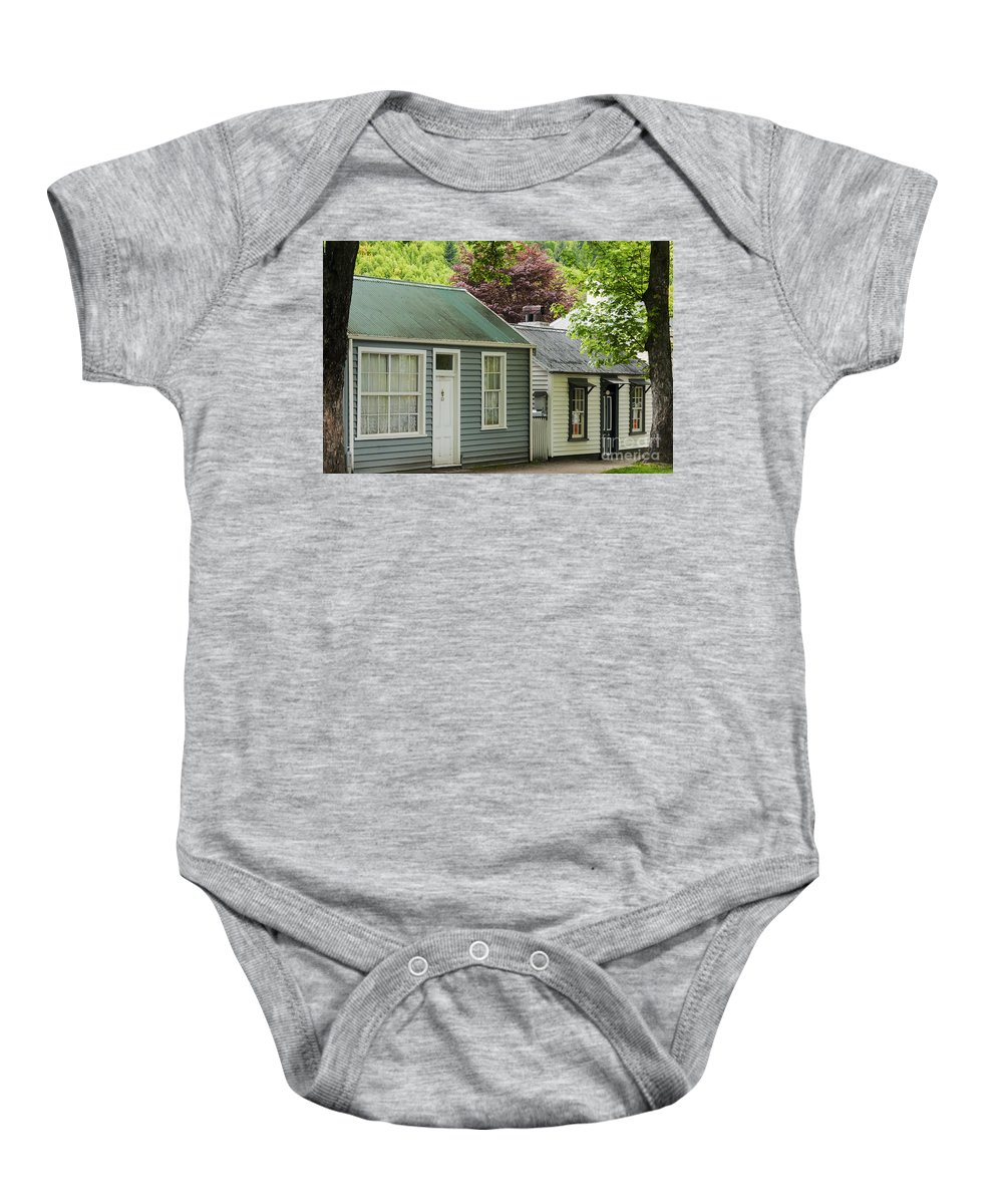 Arrow Town New Zealand Buckingham Street Cottages Cottage City Cities Cityscape Cityscapes House Houses Building Buildings Structure Structures Architecture Baby Onesie featuring the photograph Buckingham Street Cottages by Bob Phillips