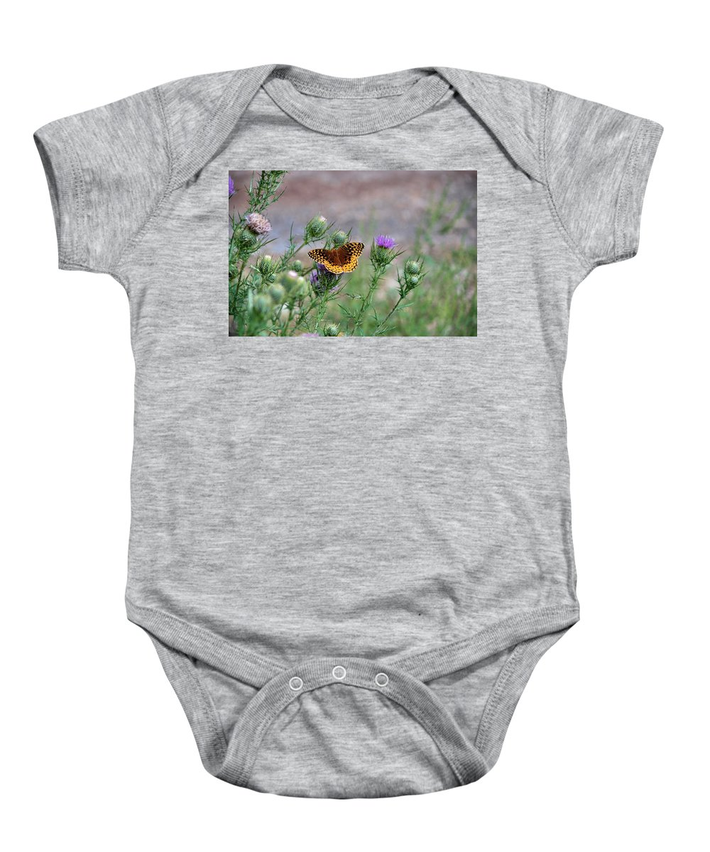 Butterfly Baby Onesie featuring the photograph Butterfly On Thistle by Francie Davis