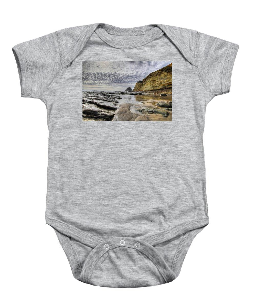 Cape Kiwanda Baby Onesie featuring the photograph Cape Kiwanda And Haystack Rock by David Gn