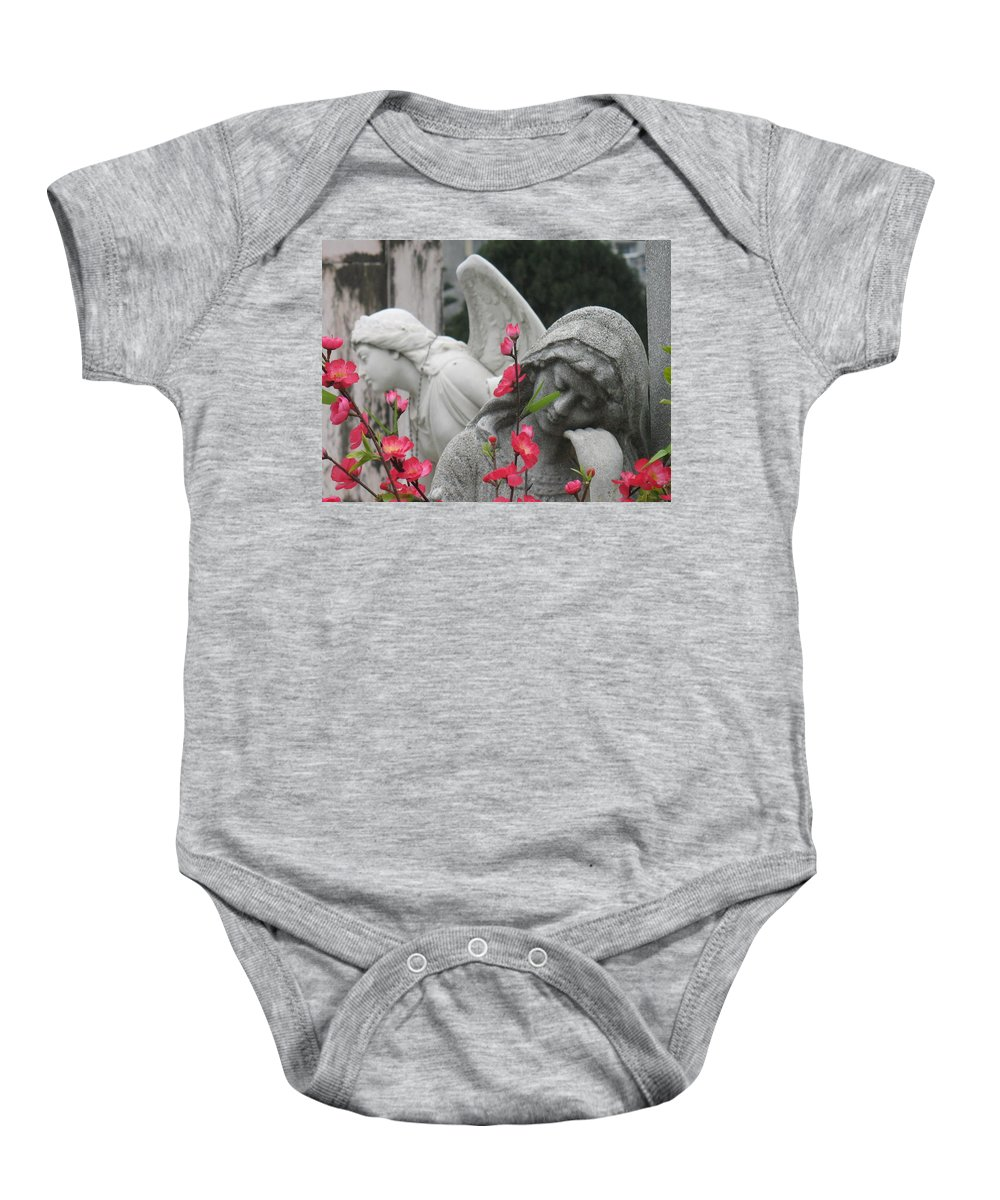 Cemetery Baby Onesie featuring the photograph Cemetery Stone Angels And Flowers by Ian Mcadie