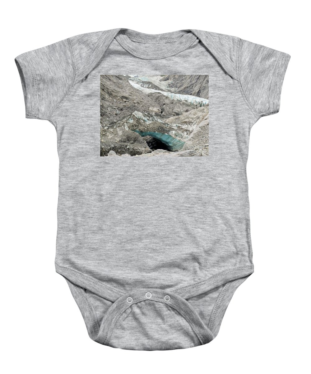Alpine Baby Onesie featuring the photograph Climate Change Melting Glacier Ice And Sheer Rock by Stephan Pietzko