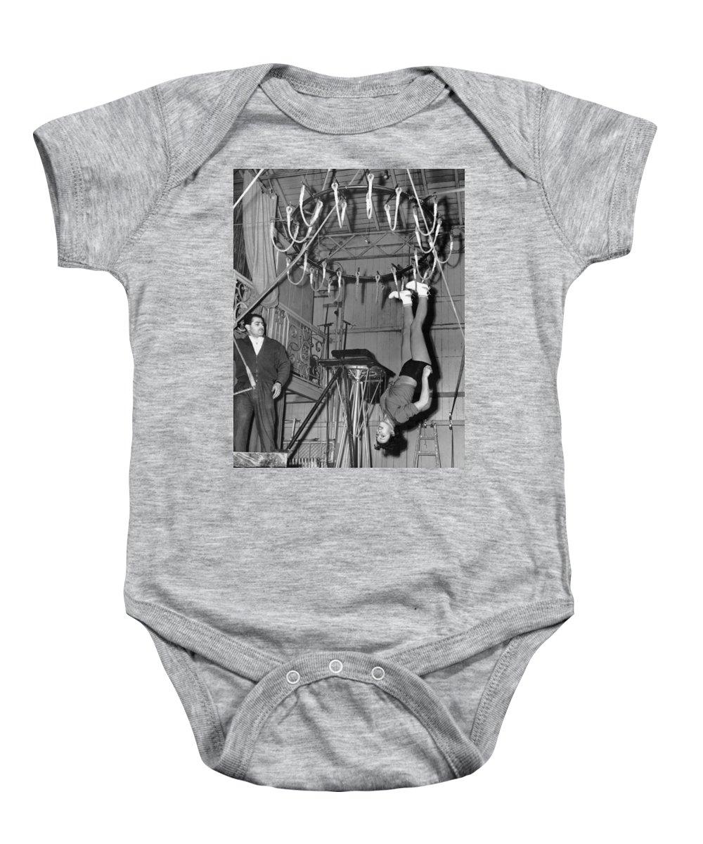 1954 Baby Onesie featuring the photograph Cora Camoin Walks On Ceiling by Underwood Archives