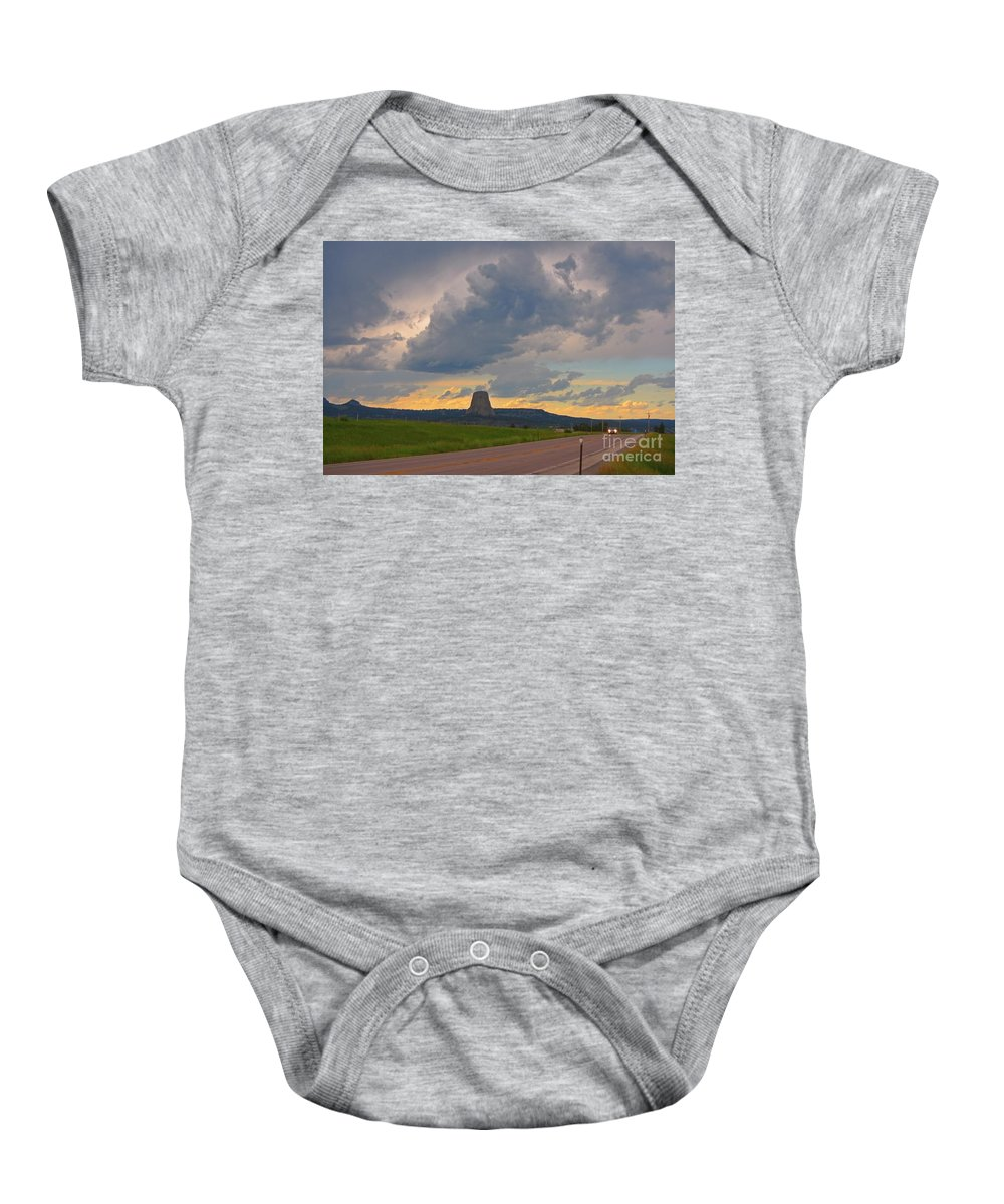 Geology Prints Baby Onesie featuring the photograph Devils Tower On The Horizon At Sunset by John Malone