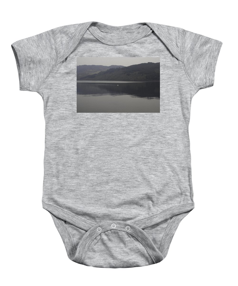 Action Baby Onesie featuring the digital art Distant View Of A White Goose Swimming Peacefully In The Morning by Ashish Agarwal