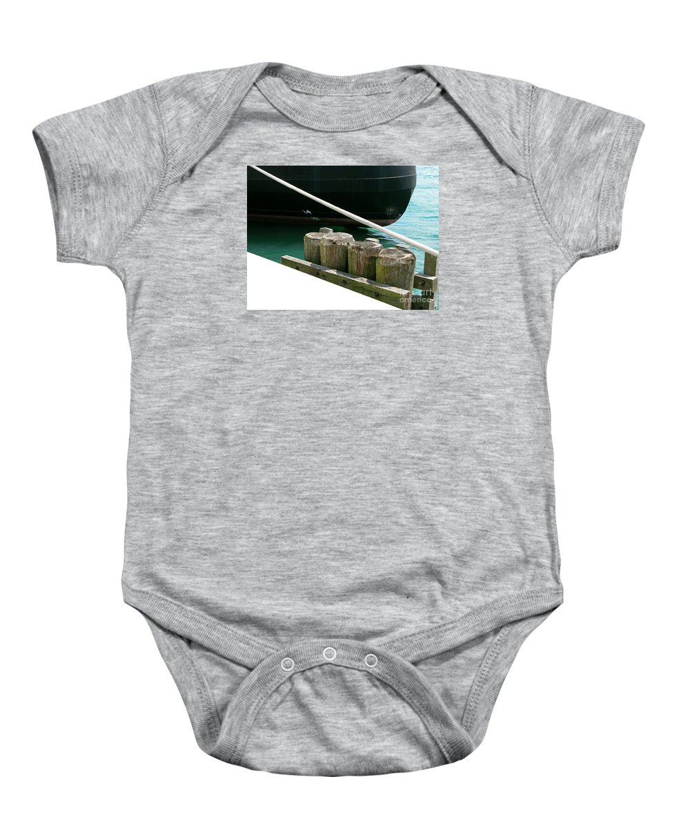 Ship Baby Onesie featuring the photograph Docked by Ann Horn