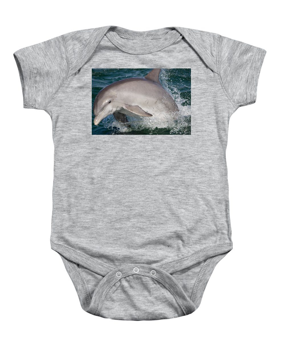 Dolphins Baby Onesie featuring the photograph Dolphin Jumping by John Greco