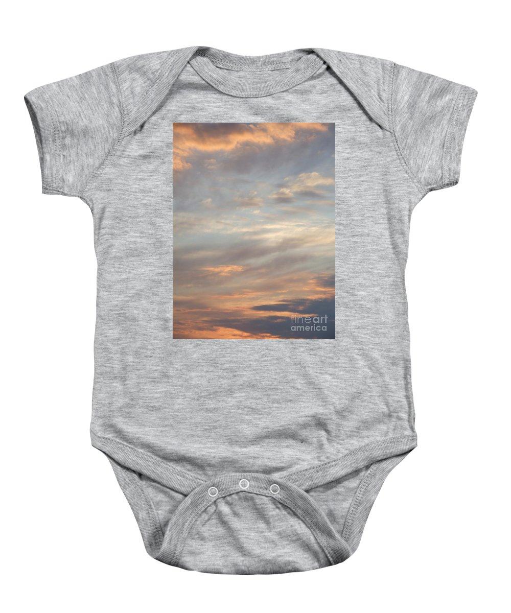 Dreamy Baby Onesie featuring the photograph Dreamy Sunset Sky by Antony McAulay