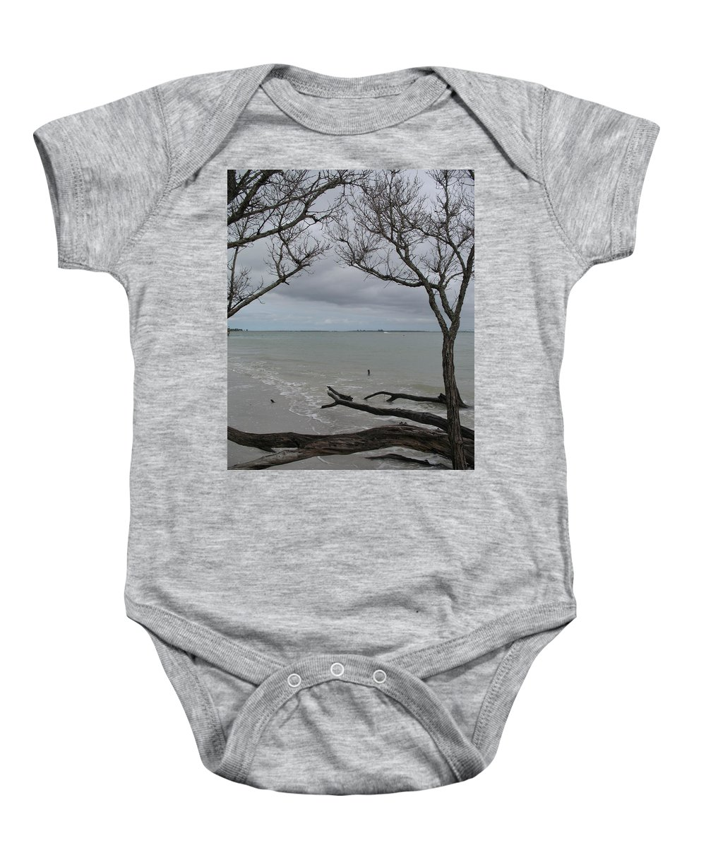 Beach Baby Onesie featuring the photograph Driftwood On The Beach by Christiane Schulze Art And Photography