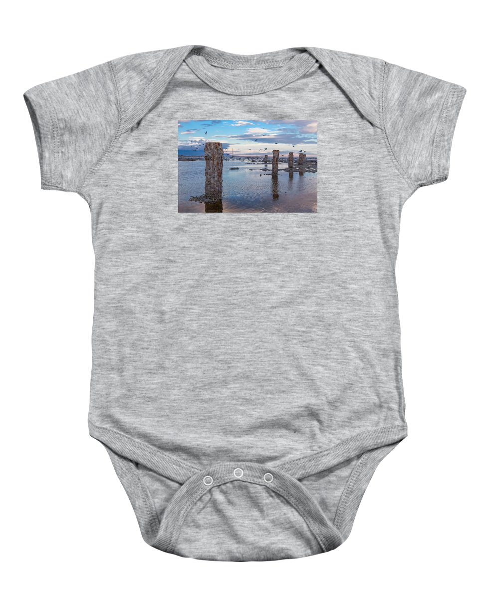 Pilings Baby Onesie featuring the photograph Drying Dock by Scott Campbell