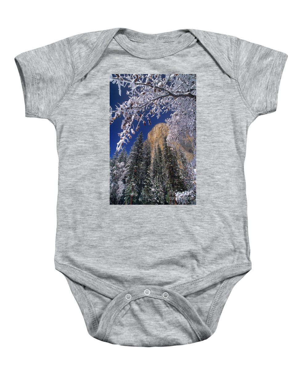 America Baby Onesie featuring the photograph El Capitan Framed By Snow Covered Black Oaks California by Dave Welling