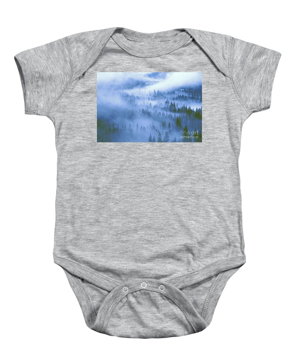 North America Baby Onesie featuring the photograph Fir Trees Shrouded In Fog In Yosemite Valley by Dave Welling