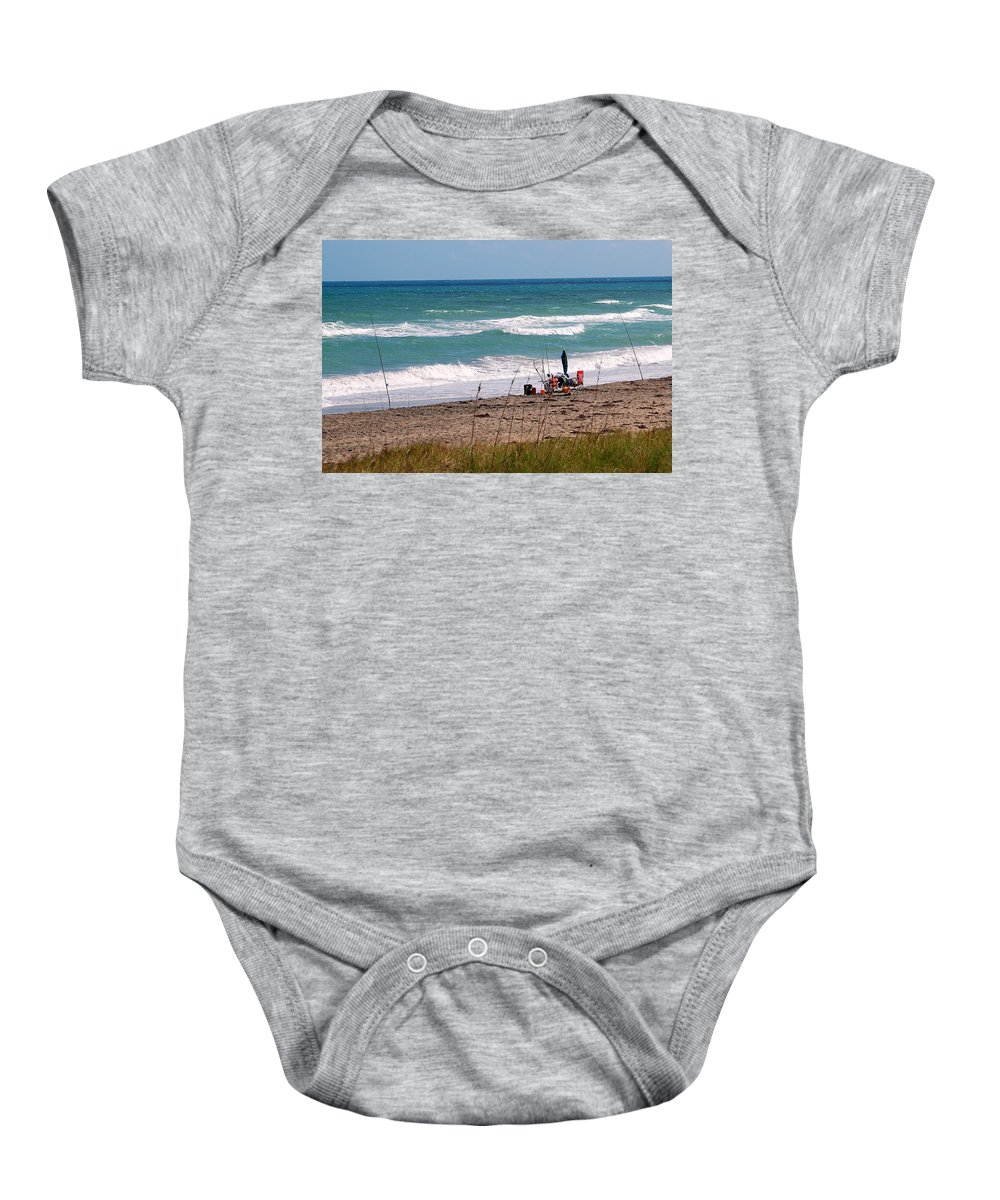 Ocean Baby Onesie featuring the photograph Fishing On The Beach by Larry Ward